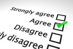 "An image of a portion of a diagonally-positioned survey. There are four check-boxes: strongly agree, agree, disagree, and strongly disagree. There is a bright green checkmark in the ""agree"" box."