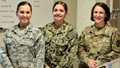 Three women in military uniforms standing together