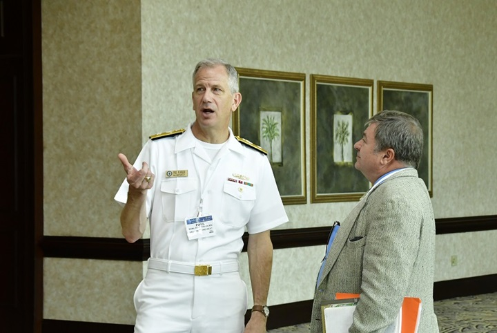 Rear Adm. Paul Pearigen, commander, Navy Medicine West (NMW) and chief of the Navy Medical Corps, and Dr. Kenneth Earhart, Naval Health Research Center's (NHRC) science director, at the 2017 Military Health System Research Symposium (MHSRS).