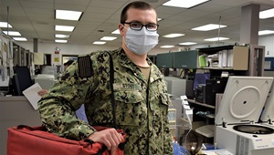 Man wearing a mask in an office environment