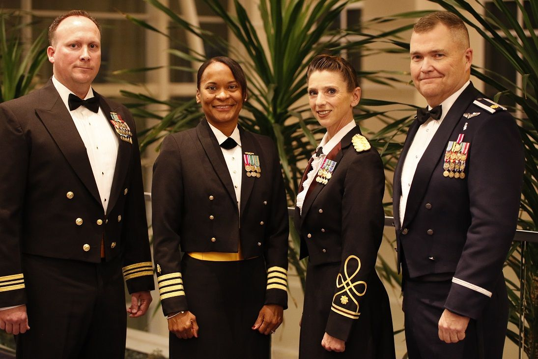 The recipients of the 2016 MHS Federal Military Nursing Excellence in Leadership Awards are (left to right): Nursing Junior (Navy) Lt. Cmdr. Shane Lawson, Pre-Commissioning Unit GERALD R. FORD (CVN 78), Norfolk, Virginia; Nursing Senior (MHS) Navy Capt. Andrea Petrovanie, Naval Medical Center San Diego; Nursing Junior (Army) Maj. Danielle Rodondi, Medical Department Center and School, Health Readiness Center of Excellence, Fort Sam Houston, Texas; and Nursing Junior (Air Force) Maj. Marion Foreman Jr., 412th Medical Group, Edwards AFB, California. (MHS photo by John Davis)