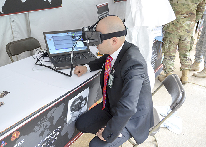Dr. Marcello Pilia of the U.S. Army Medical Research and Materiel Command's Combat Casualty Care Research Program tests the I-Portal PAS tool - one of several emerging TBI detection devices - during a presentation at the Pentagon in May 2017. (Photo Credit: Adam Wyatt, TATRC)