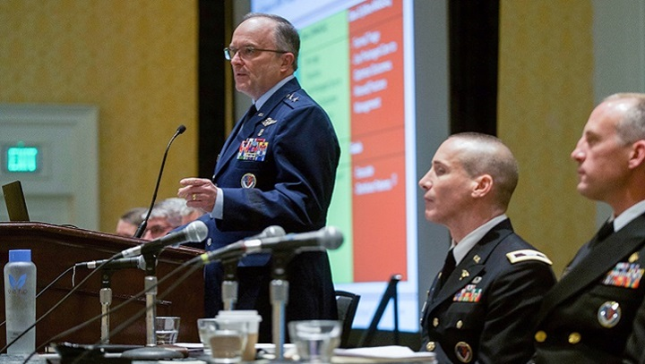 Air Force Maj. Gen. Lee Payne, assistant director of DHA's Combat Support Agency, moderates a panel presentation on Wednesday, August 21 at MHSRS. (MHS photo)