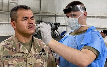 Soldier getting  nasal swab test for COVID-19
