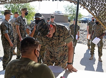 Military personnel standing in line to sign up for the flu shot