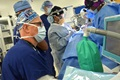 "Navy Cmdr. Cary Schultz, a certified registered nurse anesthetist at Naval Hospital Jacksonville, monitors anesthesia levels during surgery in the operating room. ""Our entire surgical team ensures that our fighting team is able to receive the treatment needed to keep them at top physical performance and ensure mission readiness,"" said Schultz. The hospital was one of four MHS facilities recognized for exemplary surgical patient care in calendar year 2017. (U.S. Navy photo by Jacob Sippel)"