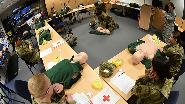 Images of soldiers practicing CPR on dummies