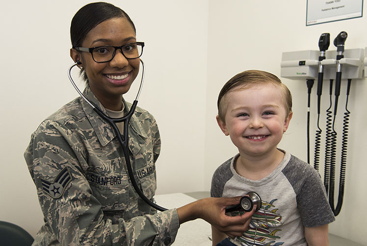 A senior airman of 366th Medical Support Squadron pediatric clinic checks vitals of the child of its service member at Mountain Home Air Force Base in Idaho. (Photo courtesy of U.S. Air Force)
