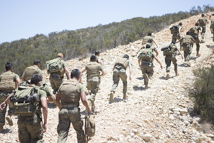 U.S. Marines sprint uphill during a field training exercise at Marine Corps Air Station Miramar, California. to maintain contact with an aviation combat element, teaching and sustaining their proficiency in setting up and maintaining communication equipment. (Photo Courtesy: U.S. Marine Corps)