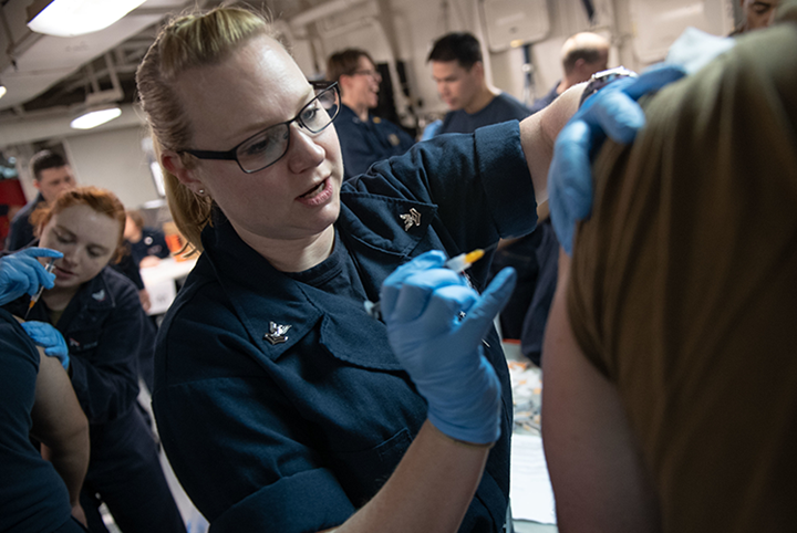 Adminstration of a seasonal flu vaccination. (U.S. Navy photo)
