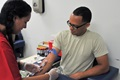 Spc. Jayson Sanchez of the Army Reserve's 77th Sustainment Brigade receives a blood draw from phlebotomist Nikole Horrell during the mass medical-readiness event hosted Aug. 8-9, 2015 by the Army Reserve's 99th Regional Support Command at Joint Base McGuire-Dix-Lakehurst, N.J., in an effort to increase Soldier readiness throughout the northeastern United States. More than 300 Army Reserve and Army National Guard Soldiers had the opportunity to take care of their Periodic Health Assessments, dental exams, vision screenings, HIV blood draws, immunizations, hearing tests, LOD processing and temporary/permanent profiles during the event. (U.S. Army photo by Sgt. Salvatore Ottaviano, 99th Readiness Division)