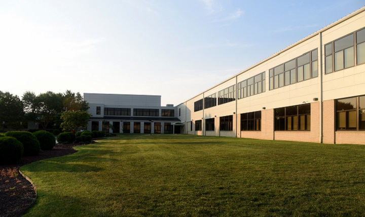 A view of the Armed Forces Medical Examiner System facility is shown July 21, 2017, on Dover Air Force Base, Delaware. Pursuant to a Base Relocation and Closure, the new AFMES facility was constructed adjoined with the Charles C. Carson Center for Mortuary Affairs. Prior to the BRAC, AFMES called Rockville, Maryland, home. (U.S. Air Force photo by Senior Airman Ashlin Federick)