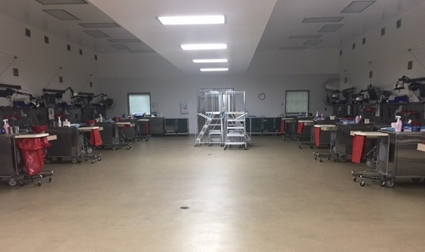 A view of the autopsy suite is shown August 30, 2017, at the Armed Forces Medical Examiner System on Dover Air Force Base, Delaware. Consistent with the capability of accommodating large numbers of fatalities, the main autopsy suite was designed to provide optimal conditions, whether there is only one examination or more than 20. (Courtesy photo)
