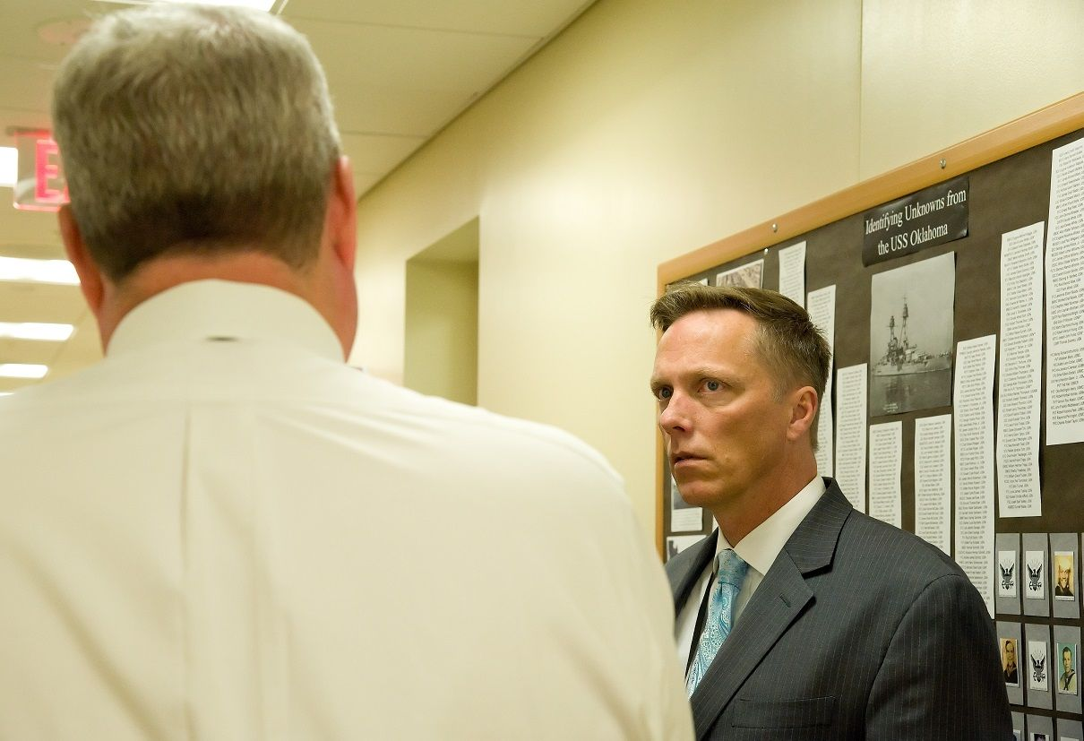 Todd Weiler, Assistant Secretary of Defense for Manpower and Reserve Affairs, listens to Dr. Timothy McMahon, Chief of Forensic Services for the Armed Forces DNA Identification Laboratory, explain the different types of identification procedures used to identify remains recovered from the USS Oklahoma and processed by the AFDIL Nov. 4, 2016, at AFMES on Dover Air Force Base, Del. The AFDIL, a subdivision of AFMES, is the sole Department of Defense DNA laboratory tasked with identifying human remains from current and past conflicts. (U.S. Air Force photo by Roland Balik)