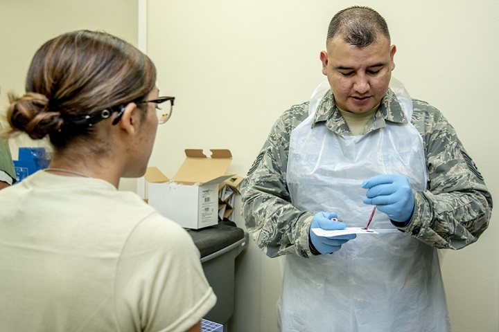 Air Force Tech. Sgt. Ricky Penuelaz, 59th Medical Wing lab technician, uses a pipette to put blood on an Air Force trainee's DNA card. The Armed Forces Medical Examiner System-Armed Forces Repository of Specimen Samples of the Identification of Remains inspected Lackland Air Force Base, Texas, on the collection of DNA cards. AFMES-AFRSSIR is responsible for managing, coordinating and maintaining the collection of DNA blood reference cards for all active duty, reserve, and National Guard service members. This is done when service members first enter the military and is collected at one of nine basic training sites, dependent on their branch of service. (U.S. Air Force photo by Staff Sgt. Nicole Leidholm)