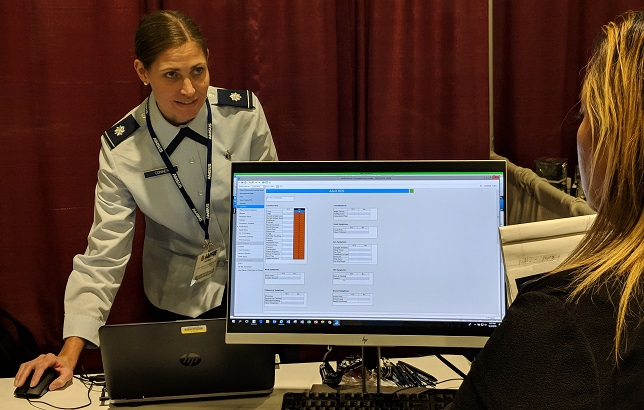 Air Force Lt. Col. (Dr.) Tara Conner, Defense Health Agency, Health Informatics User Integration Branch chief, demonstrates the capabilities and functionality of MHS GENESIS, the Department of Defense's new electronic health record, during the 2019 Society of Federal Health Professionals' annual meeting in National Harbor, Maryland. MHS GENESIS will deploy in phases to all DoD military treatment facilities by 2023. (DHA photo by Mark Oswell)
