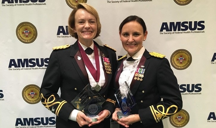 Army Col. Mary V. Krueger (left), commander of Tripler Army Medical Center, Hawaii, and Army  Maj. Katie L. Westerfield, a battalion surgeon with First Security Forces Assistance Brigade, received Female Physician Leadership Awards during the annual conference of AMSUS, the Society of Federal Health Professionals. (Courtesy photo)