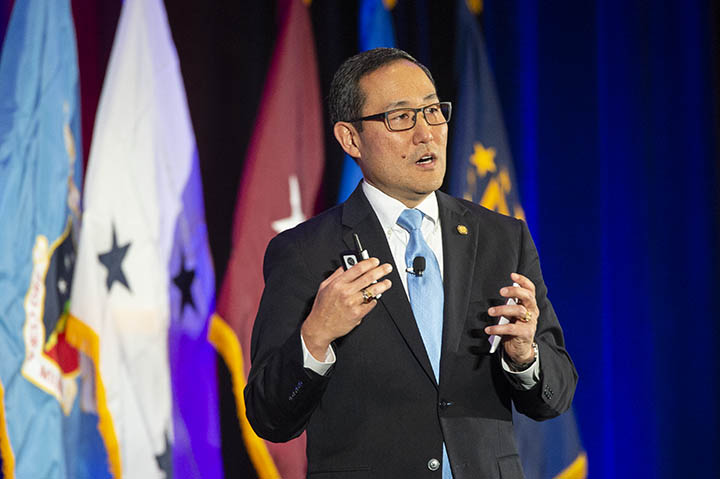 Mr. Guy Kiyokawa, deputy director of the Defense Health Agency (DHA), delivers remarks during the AMSUS 2018 DHA general session.