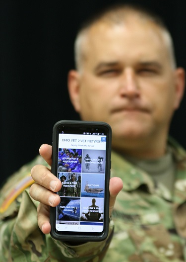 Ohio Army National Guard Capt. Michael Barnes talks to a Soldier about the Ohio Vet 2 Vet Network, a website and mobile app with information and resources for military veterans and their families to combat the risk factors of suicide among veterans. (U.S. Army photo by Staff Sgt. Michael Carden)