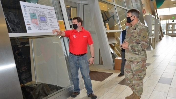Image of a contractor and a soldier looking at a blueprint