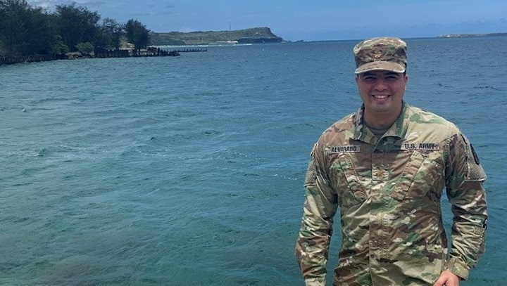 Image of soldier standing, surrounded by tropical water