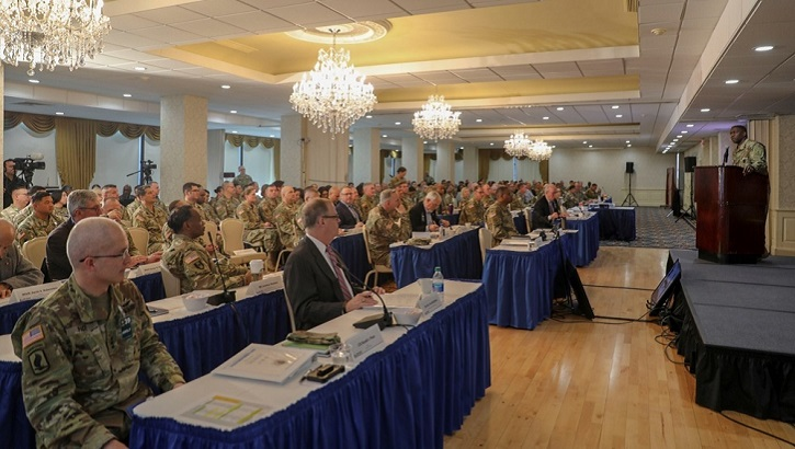 Key leaders at the Army Medicine Senior Leader Forum watch Lt. Gen. R. Scott Dingle, Army Surgeon General, at podium during the Army Medicine Senior Leaders Forum on Jan. 28, 2020, to discuss issues related to the transformation of Army Medicine and how to manage the way ahead to ensure optimal medical readiness for soldiers and all military medical beneficiaries. Attendees include the Director of the Defense Health Agency, Army  Lt. Gen. Ronald Place (left foreground), and Assistant Secretary of Defense (Health Affairs) Thomas McCaffery (center foreground). The forum was held at Fort Belvoir and involved about 350 leaders. (U.S. Army photo by Jenie Fisher)