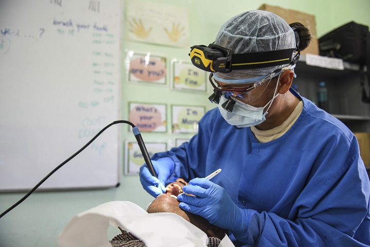 Air Force Master Sgt. Emeriles Curry, 346th Expeditionary Medical Operations Squadron dental hygienist, provides dental care to a local man in the Coclé Province of Panama. To date, in 2-weeks' worth of Medical Readiness Training Exercises, the teams working in conjunction with the Panamanian Ministry of Health, have seen nearly 4,700 patients. The medical team is participating in Exercise New Horizons 2018, which is a joint training exercise focused on medical, civil engineer and support service personnel's ability to prepare, deploy, operate, and redeploy outside the United States. (U.S. Air Force photo by Senior Airman Dustin Mullen)