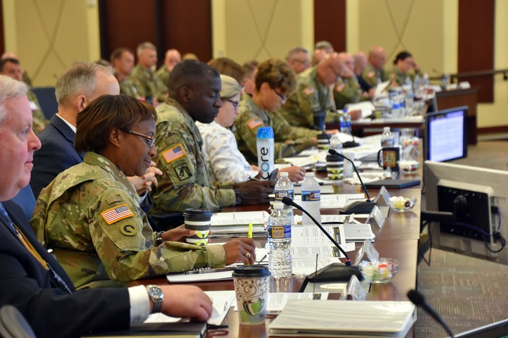 Leaders from across the Department of Defense, the Army and Fort Bragg meet at U.S. Army Forces Command headquarters July 19, 2018, to discuss the upcoming transition of the administration and management of Womack Army Medical Center from the U.S. Army Medical Command to the Defense Health Agency. (U.S. Army photo by Eve Meinhardt)