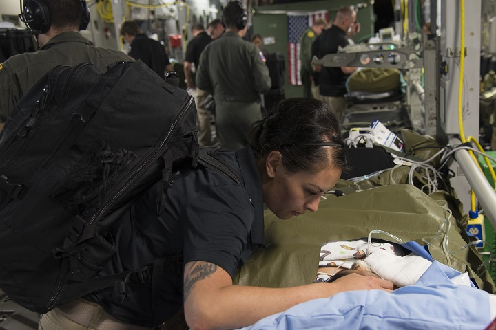 Army Capt. Argelia Felix-Camacho, a critical care nurse at the U.S. Army Institute of Surgical Research Burn Center and member of the USAISR Burn Center Burn Flight Team comforts a patient in Guatemala before a flight to the Shriner's Hospital for Children in Galveston, Texas. (U.S. Air Force photo by Master Sgt. Corenthia Fennell)