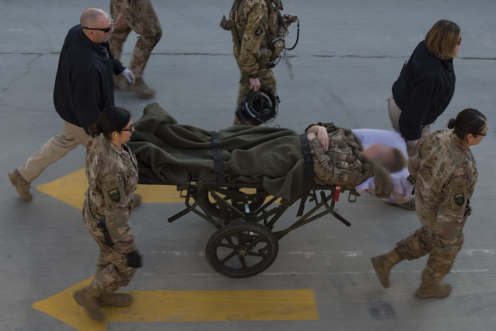 A medical team transports a patient by a stretcher to Craig Joint Theater Hospital at Bagram Airfield, Afghanistan, Dec. 10, 2018. Before entering the hospital, patients are thoroughly assessed, administratively in-processed and checked for any explosive ordnance or weapons. (U.S. Air Force photo by Senior Airman Kaylee Dubois)