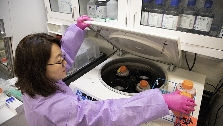 Misook Choe, a laboratory manager with the Emerging Infectious Disease branch at the Walter Reed Army Institute of Research in Silver Spring, Md., runs a test during research into a solution for the new coronavirus, COVID-19, March 3, 2020. The Emerging Infectious Diseases branch, established in 2018, has the explicit mission to survey, anticipate and counter the mounting threat of emerging infectious diseases of key importance to U.S. forces in the homeland and abroad. (U.S. Army Sgt. Michael Walters)