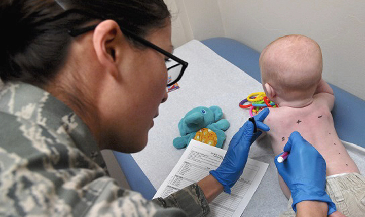 Air Force Senior Airman Catherine Settles, 633rd Medical Group aerospace medical technician, numbers a baby's back to record which allergen will be applied for a skin prick test at U.S. Air Force Hospital Langley, Virginia. The allergy clinic also conducts skin patch and oral challenge tests to identify a patient's allergies. (U.S. Air Force photo by Airman 1st Class Austin Harvill)