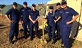 A Coast Guard medical team oversees a temporary tent city set up in Key West, Florida, to shelter service members assisting with hurricane recovery efforts. Pictured left to right: Cmdr. Rob Kuhl, Capt. Ezequias Sanchez-Olmo, HS3 Christopher Roche, HS2 Lauren Coghill, HS2 Ivan Castro, and Cmdr. Justin Eubanks. (U.S. Coast Guard)