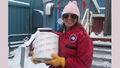 Army Capt. Austin Leedy, veterinary food safety officer from Public Health Activity-San Diego, carries a container of ice cream out of a shipping container at Palmer Station, Antarctica, October 2019. U.S. Army Public Health Command-Pacific veterinary food safety officers partner with the National Science Foundation to ensure Palmer Station has a safe food supply and to perform independent food inspections throughout the entire annual resupply process. (Courtesy photo)