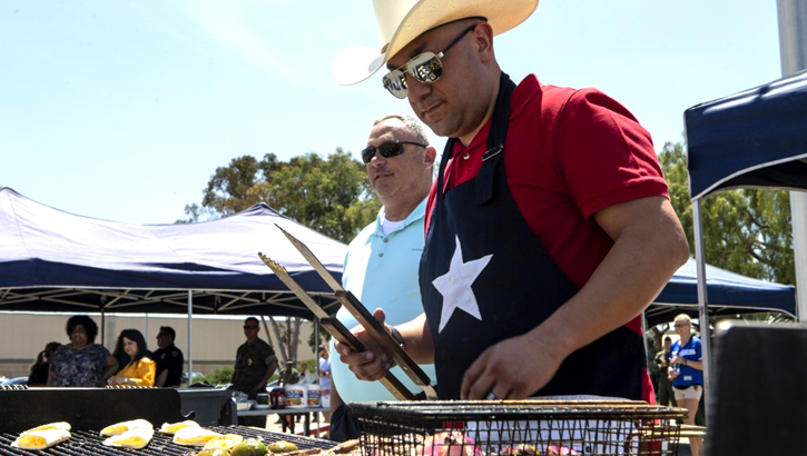 Marine Gunnery Sgt. Mario Cardenas, with Provost Marshal's Office, Headquarters and Headquarters Squadron, prepares lunch for the H&HS Barbecue Cook-off at Marine Corps Air Station Miramar, California. (U.S. Marine Corps photo by Lance Cpl. Andrew Hiatt)