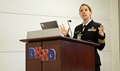 Public Health Service Cmdr. Robin Toblin with the Walter Reed Army Institute of Research was one of the more than 1,700 health care providers and policy makers from the Military Health System, the Department of Veterans Affairs, academia and commercial research companies who met in person and virtually during the recent Defense Centers of Excellence for Psychological Health and Traumatic Brain Injury Summit held at the Defense Health Headquarters in Falls Church, Virginia. (DCoE photo by Terry Welch)