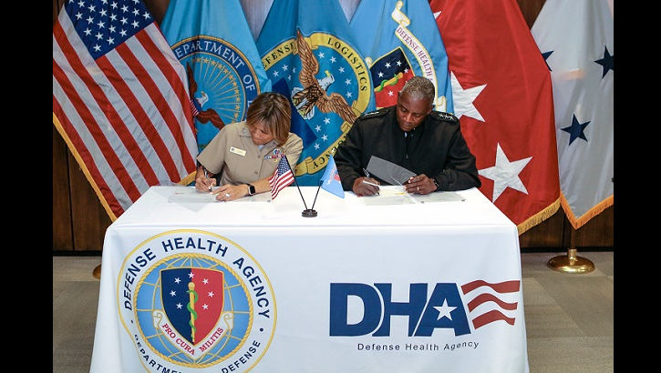 Navy Vice Adm. Raquel Bono, DHA director (left), and Army Lt. Gen. Darrell Williams, DLA director (right) signed a memorandum of agreement on Aug. 15, at Defense Health Headquarters. The agreement clarifies the agencies' complementary roles and responsibilities, avoiding duplication of effort while retaining DLA as DHA's acquisition enabler of choice for medical materiel. (MHS photo)
