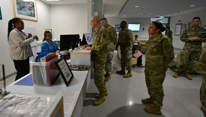 Army Lt. Gen. Ronald Place (center), director of the Defense Health Agency, talks to two civilian staff personnel during a recent visited the U.S. Army Health Clinic Stuttgart, Sept. 11, 2019, Stuttgart, Germany. The Department of Defense is preparing for the next major step in consolidating military hospitals and clinics under a single agency, one of the largest organizational changes within the U.S. military in decades. (U.S. Army photo by Rey Ramon)