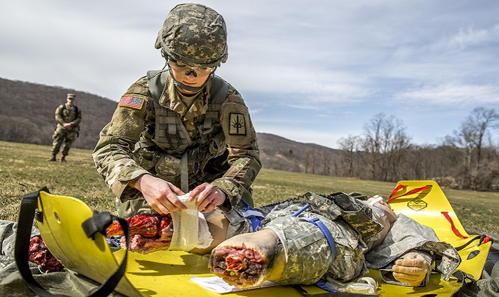 U.S. Army Spc. Courtney Natal provides aid to a simulated casualty. Born out of