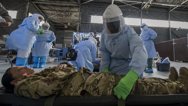 Air Force Staff Sgt. Lee Nembhard, an aeromedical evacuation technician assigned to the 375th Aeromedical Evacuation Squadron from Scott Air Force Base, Illinois, straps a simulated Ebola patient to a litter during a Transport Isolation System training exercise at Joint Base Charleston, South Carolina. (U.S. Air Force photo by Senior Airman Megan Munoz)