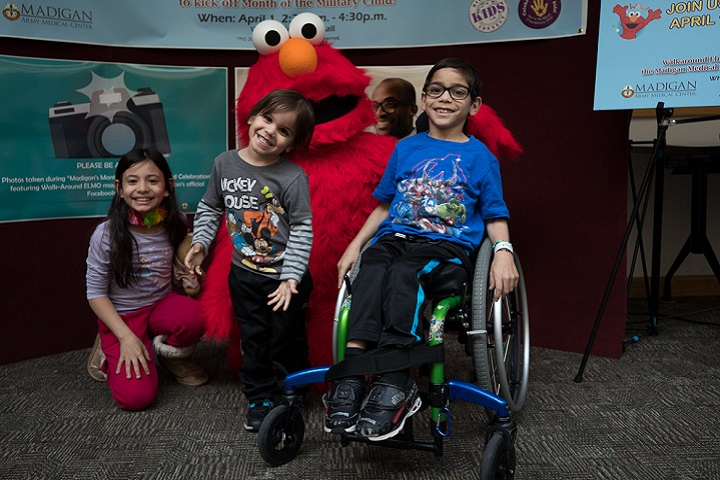 Sesame Street's Walkaround Elmo visited Madigan Army Medical Center families on April 1 to celebrate the seven-year anniversary of Military Kids Connect and the recent relaunch of its website. (U.S. Army photo by Ryan Graham)