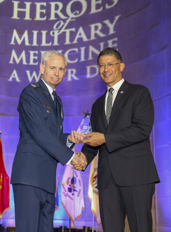 Air Force Col. William E. Nelson, chief, integrated and international operational medicine, 711th Human Performance Wing, is presented a 2018 Heroes of Military Medicine Award in Washington, D.C., May 3, 2018, by Army Maj. Gen. (retired) Joseph Caravalho, president, Henry M. Jackson Foundation for the Advancement of Military Medicine. Colonel Nelson was recognized for his exemplary career as an Air Force flight surgeon and for his contributions to the Air Force Integrated Operational Support mission. (Courtesy photo by the Henry M. Jackson Foundation for the Advancement of Military Medicine)