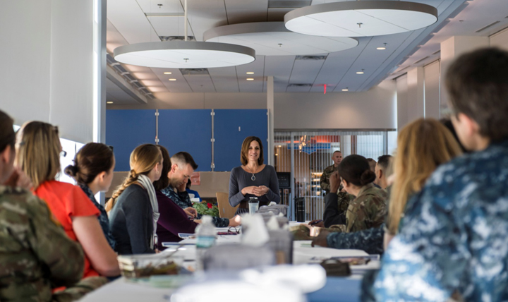 "Delilah Wieman, an Army spouse, talks with Fort Belvoir Community Hospital staff at a recent Family Readiness Group gathering. For 24 years, Wieman has stayed connected with the ""military family"" through 16 moves while raising five children. (Courtesy photo)"