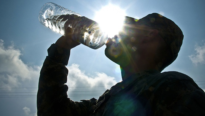 Soldier drinking from a water bottle