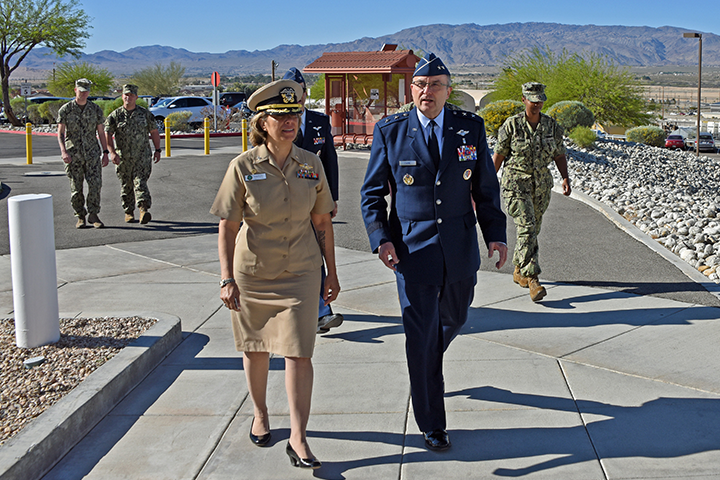 Maj. Gen. Lee Payne (right) is escorted into Naval Hospital Twentynine Palms by hospital Commanding Officer, Capt. Nadji Hariri, for a site visit on the launch of MHS GENESIS, the military's new electronic record-keeping system, April 17. (U.S. Navy photo by Dave Marks)