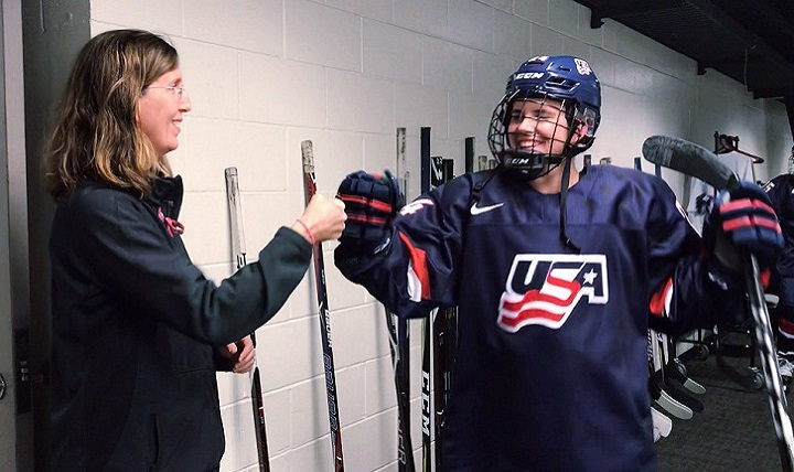 Dr. Allyson Howe fist bumps one of USA's women's ice hockey team members during the 2018 Winter Olympics in Pyeongchang, South Korea. (Photo courtesy of Allyson Howe)