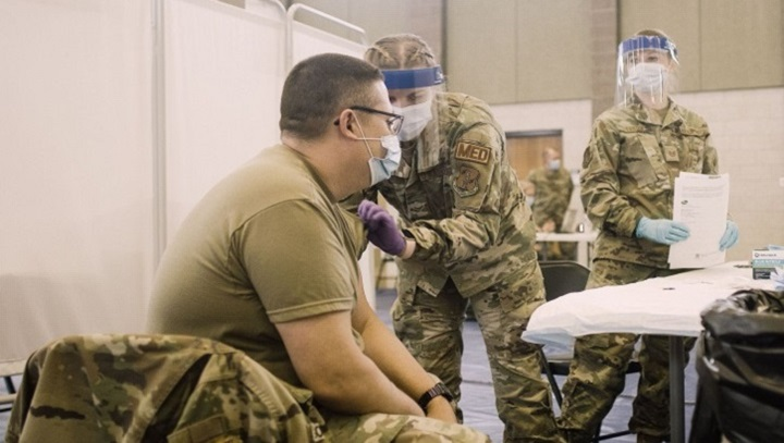 Soldier getting a vaccine in his left arm