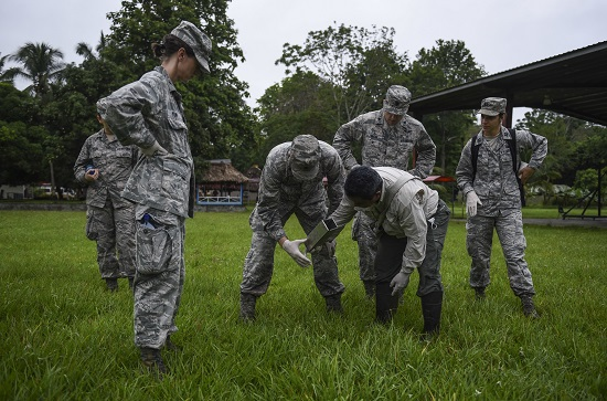 A team of U.S. Air Force members and biologists with the Gorgas Institute in Panama, check a rodent trap June in Meteti, Panama. The doctors were participating in an Emerging Infectious Diseases Training Event, in which they received informational lectures from Panamanian infectious disease experts and field studies of possible virus carrying wildlife and insects. (U.S. Air Force photo by Senior Airman Dustin Mullen)