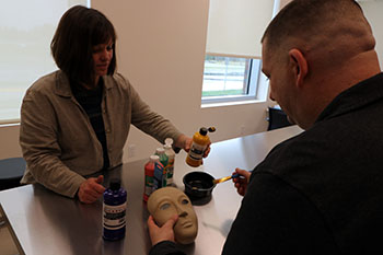 Military personnel using art therapy