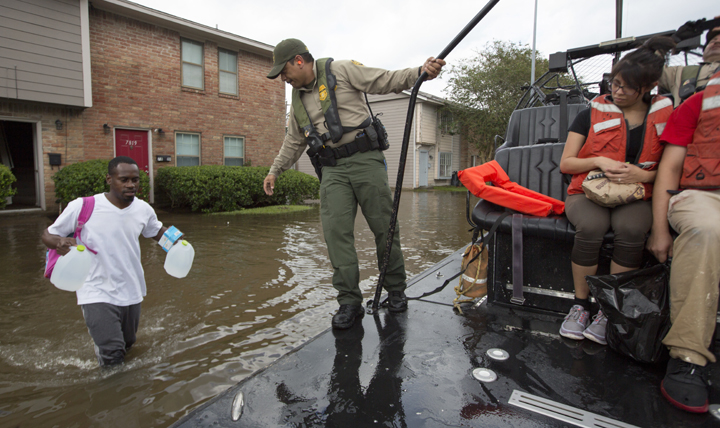 A resident of a Hurricane Harvey-flooded neighborhood in Houston gets evacuated. (U.S. Customs and Border Protection photo by Glenn Fawcett)